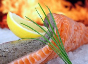 Salmon is one of the foods that help sciatica due to its oily properties