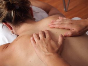 Discussion about whether massage can assist with pain relief during back pain and sciatica
